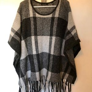 Plaid poncho with fringe